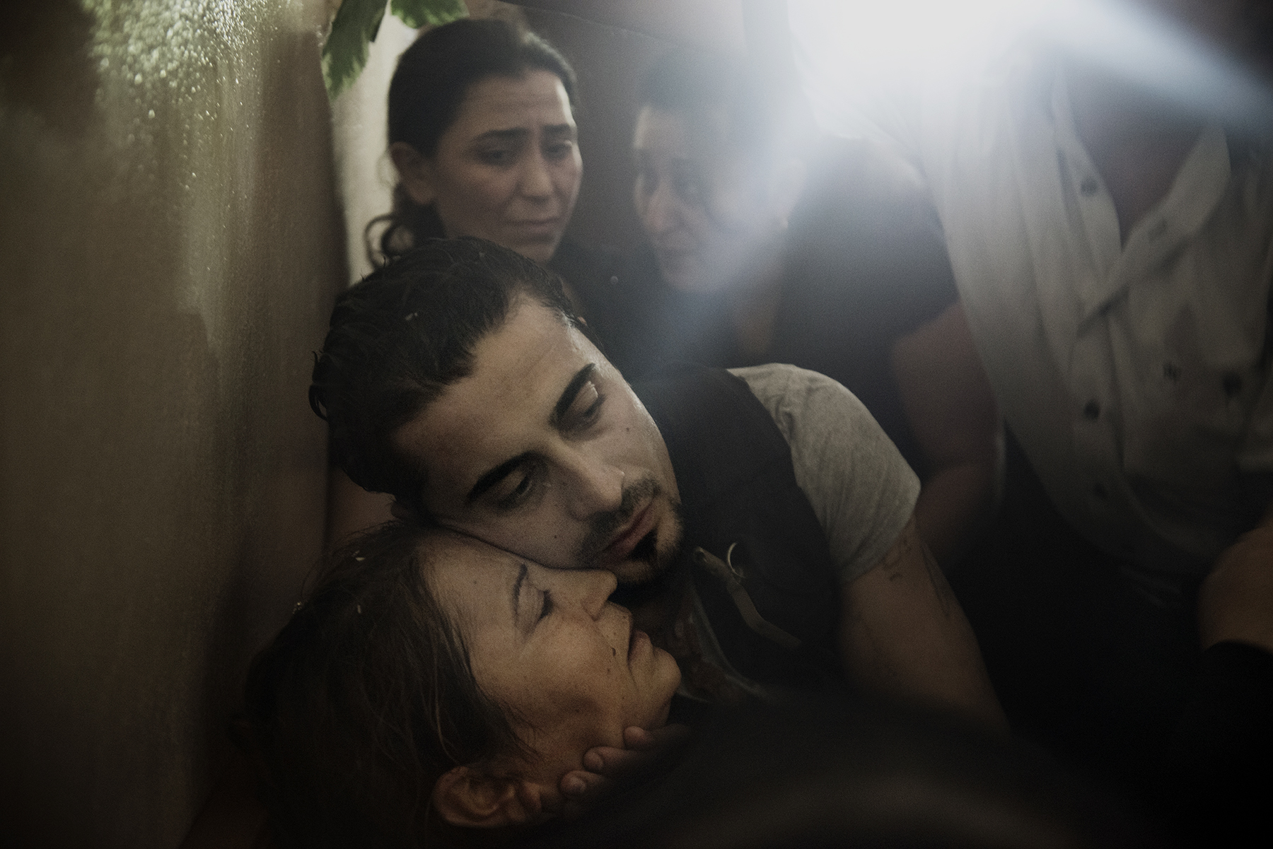 Syria, Latakia, September 2013, Bassel Barhoum hugs his mother Jamila Marshid during his brother's funeral in the village of Daqaqa in Latakia Province, Syria. Abu Layth died while fighting for the Syrian Army.