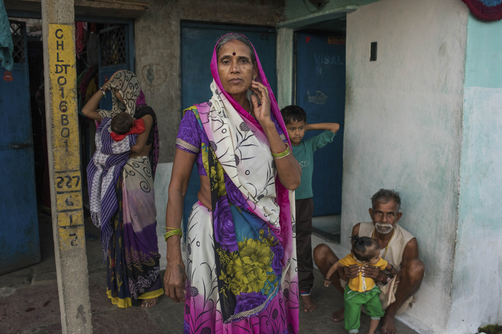India, Bhopal, 04 October 2016A family in a Bhopal slum stands outside their home toilet. Health and work has improved dramatically since toilets came to their area.Andrea Bruce / NOOR