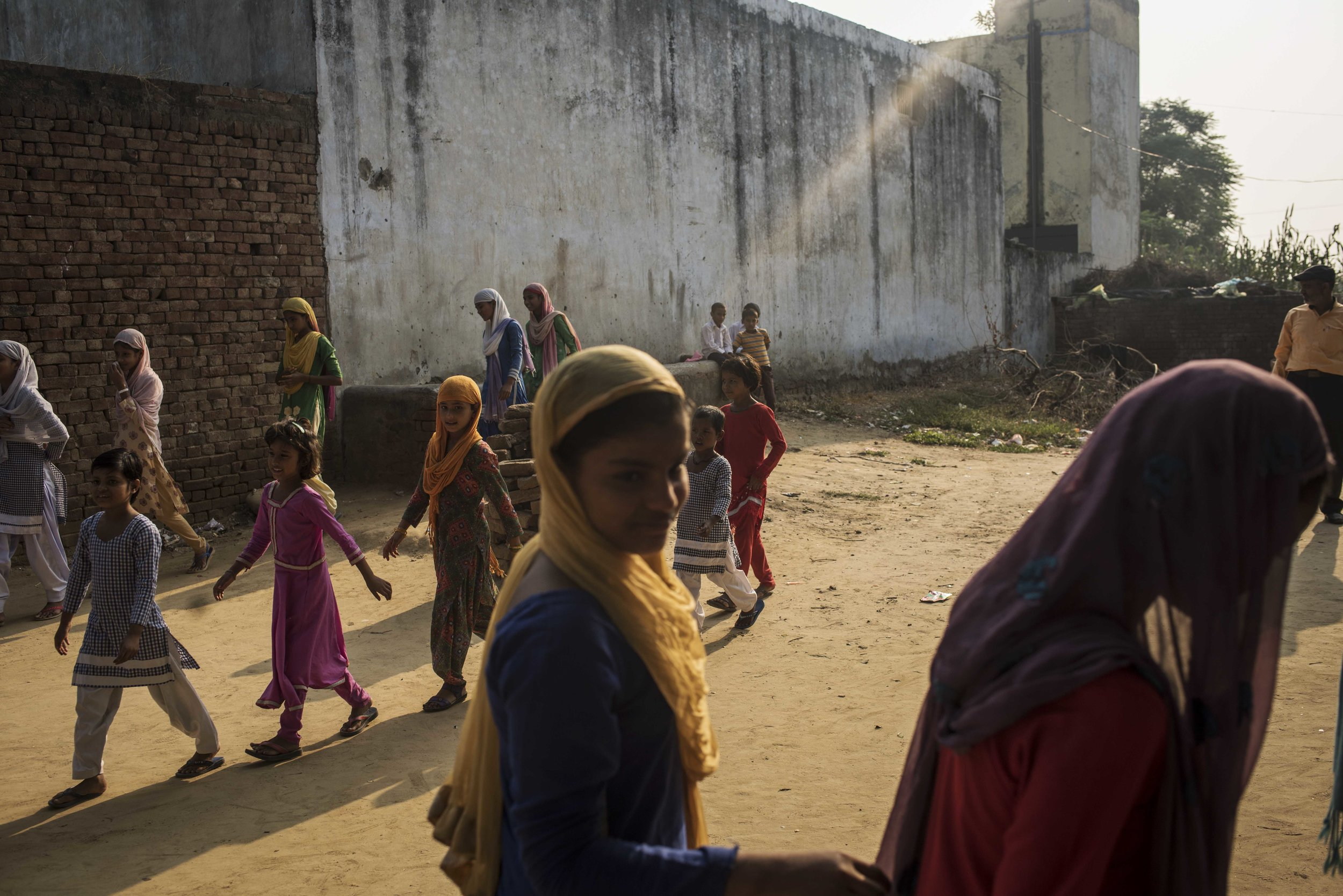 India, Uttar Pradesh, 25 September 2016, In a village in Uttar Pradesh, girls line up for school. The school doesn't have a working toilet and so the students must defecate in the nearby fields.