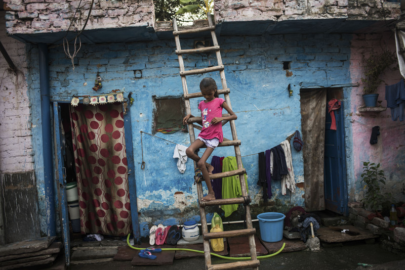 India, New Delhi, 02 October 2016, Baby, 10, sits outside her home in a New Delhi slum. Her family says she has suffers from constant diarrhea.