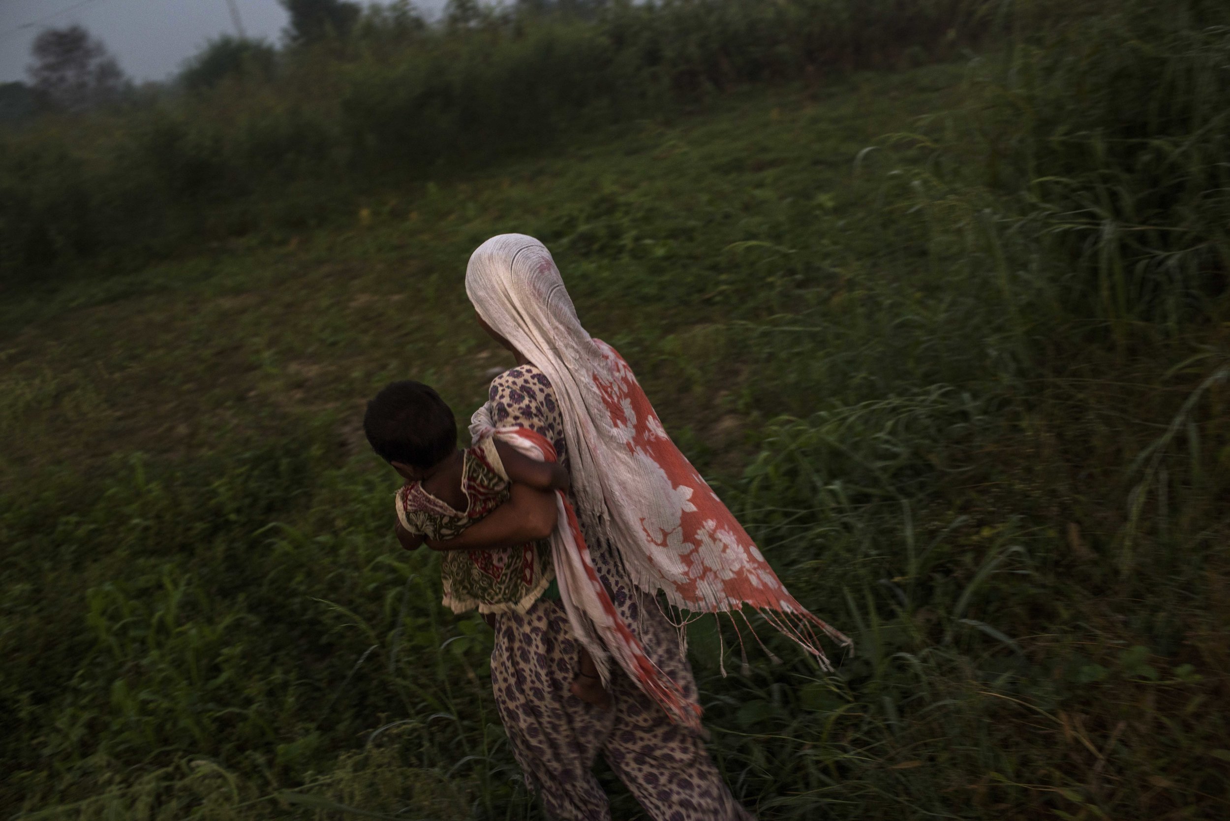 India, Peepli Kheera, 24 September 2016, A woman walks to the outdoor area where she goes to relief herself.