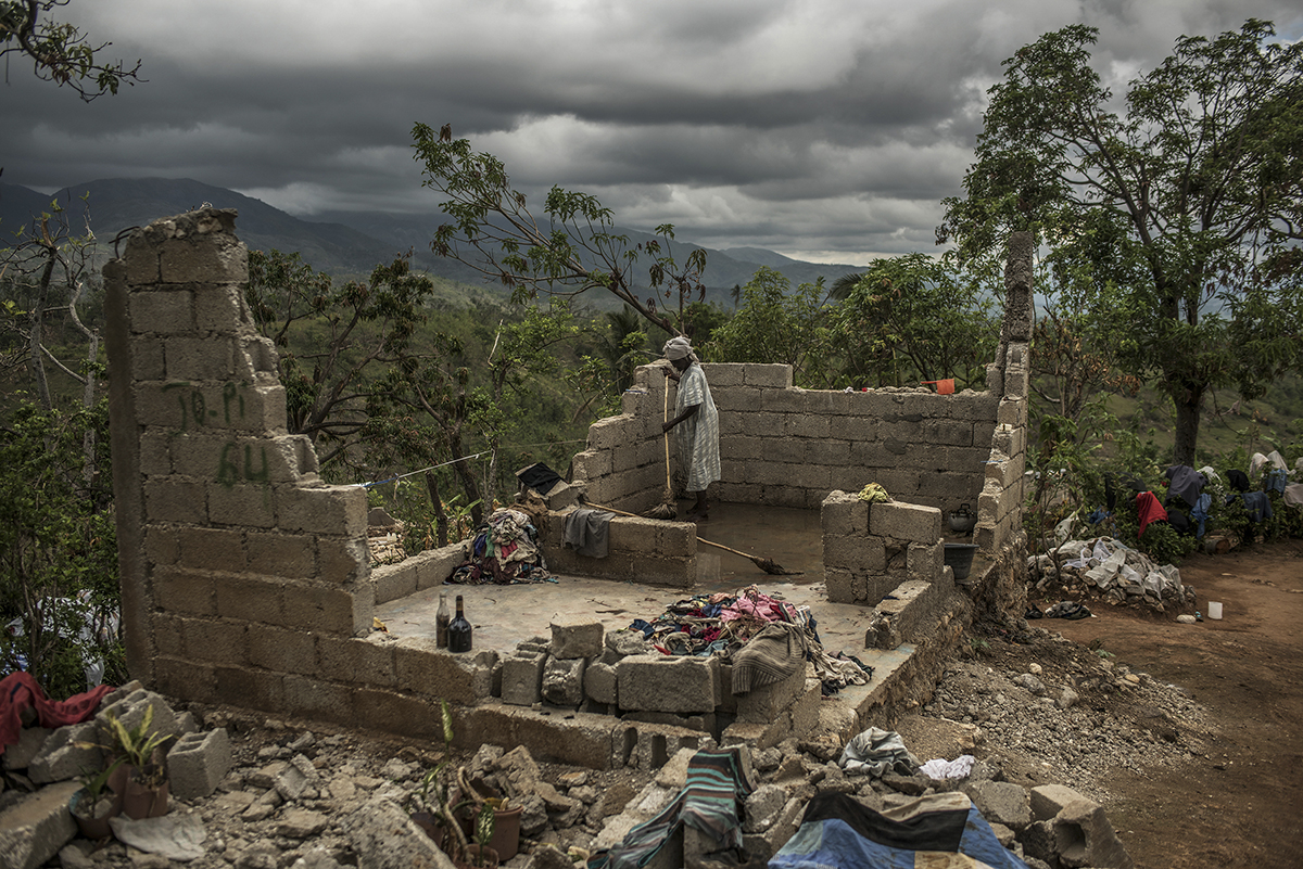 Haiti, Les Cayes, 15 November 2016, Rose Dena, 85, attempts to clean what is left of her home in the mountains of southern Haiti weeks after Hurricane Matthew.