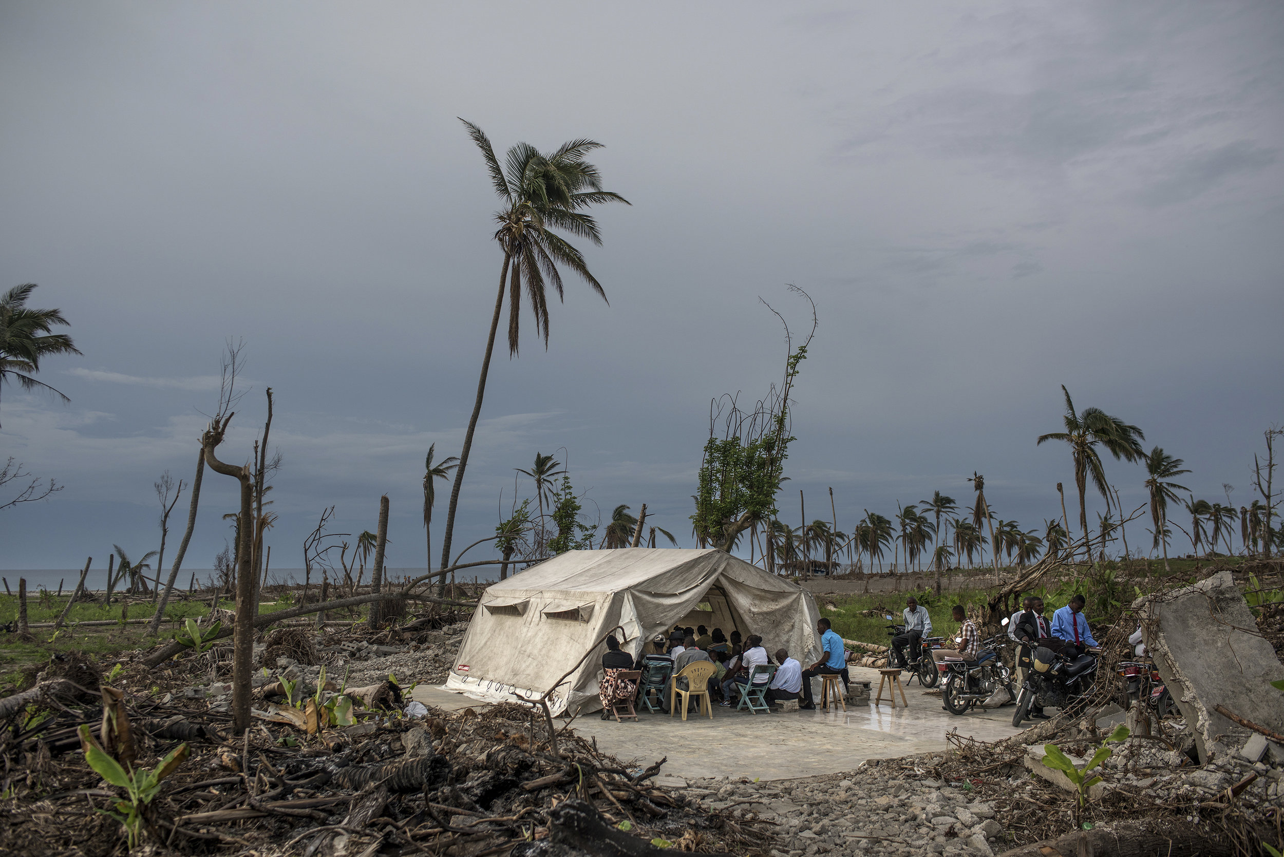 Haiti, Roche A Bateau, 19 November 2016, The Elise Adventure Morija Church was swept away during Hurricane Matthew. The parishioners still hold services on the foundation of the church, under a tent.