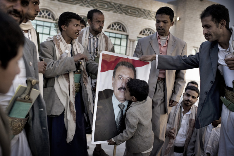 SANAA YEMEN-- MAY 2011:  A boy    kisses    a  poster of Yemen's President Ali Abdullah Saleh
