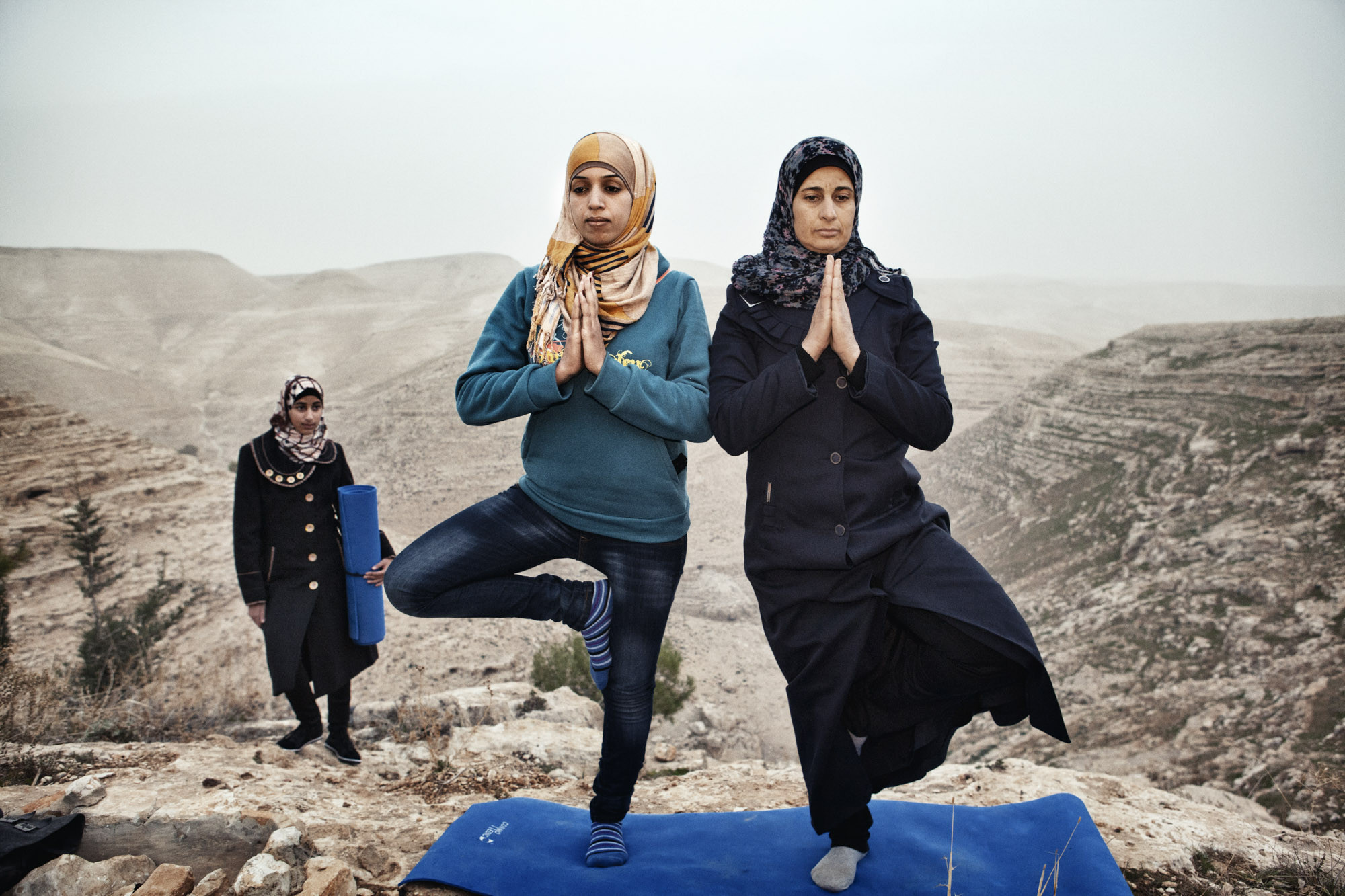 Occupied Palestinian Territories, West Bank, Za'tara, January 2013, Hayat (left) teaches yoga to the residents of her village, Zataara, on the outskirts of Bethlehem in the West Bank. The women are increasing in number each week.