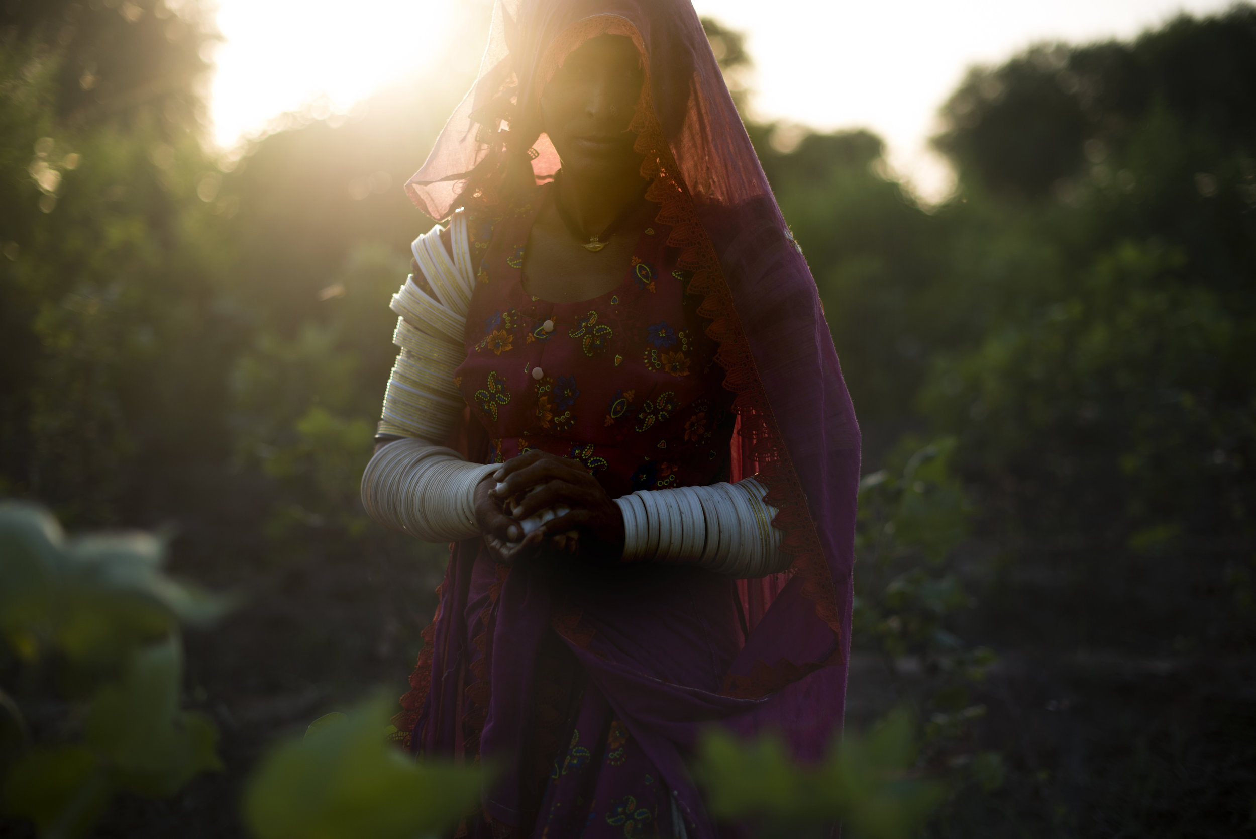 "Nanju Bheel, 25, is one of many Hindu women living and working cotton fields in southern Pakistan. ""In the day we are working in the scorching sun. In the night we are passing through the snakes,"" she said."