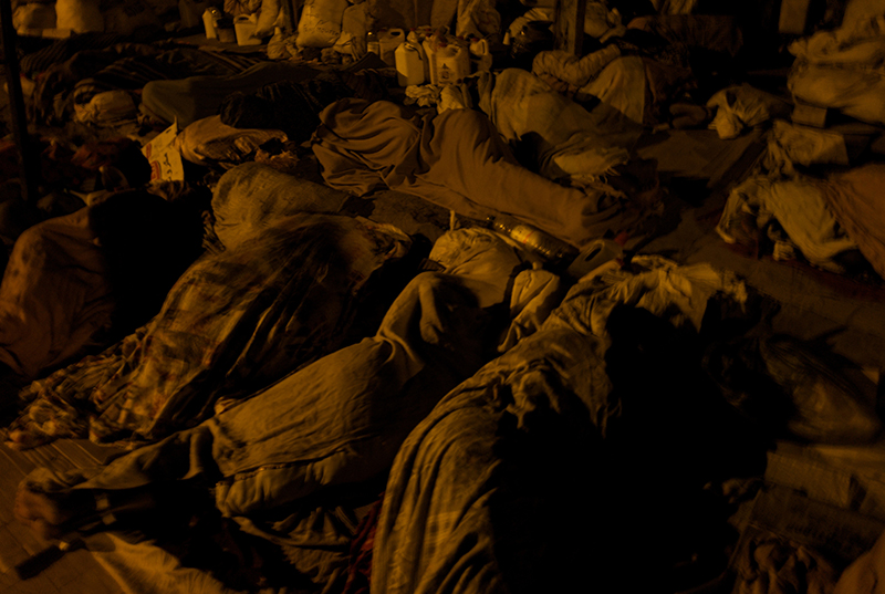 Djibouti, Djibouti, March, 2008. Covering their bodies with tattered blankets and veils, a group of thirty female refugees spend the night sleeping along the pavement in Djiboutiville's Rue Issa.