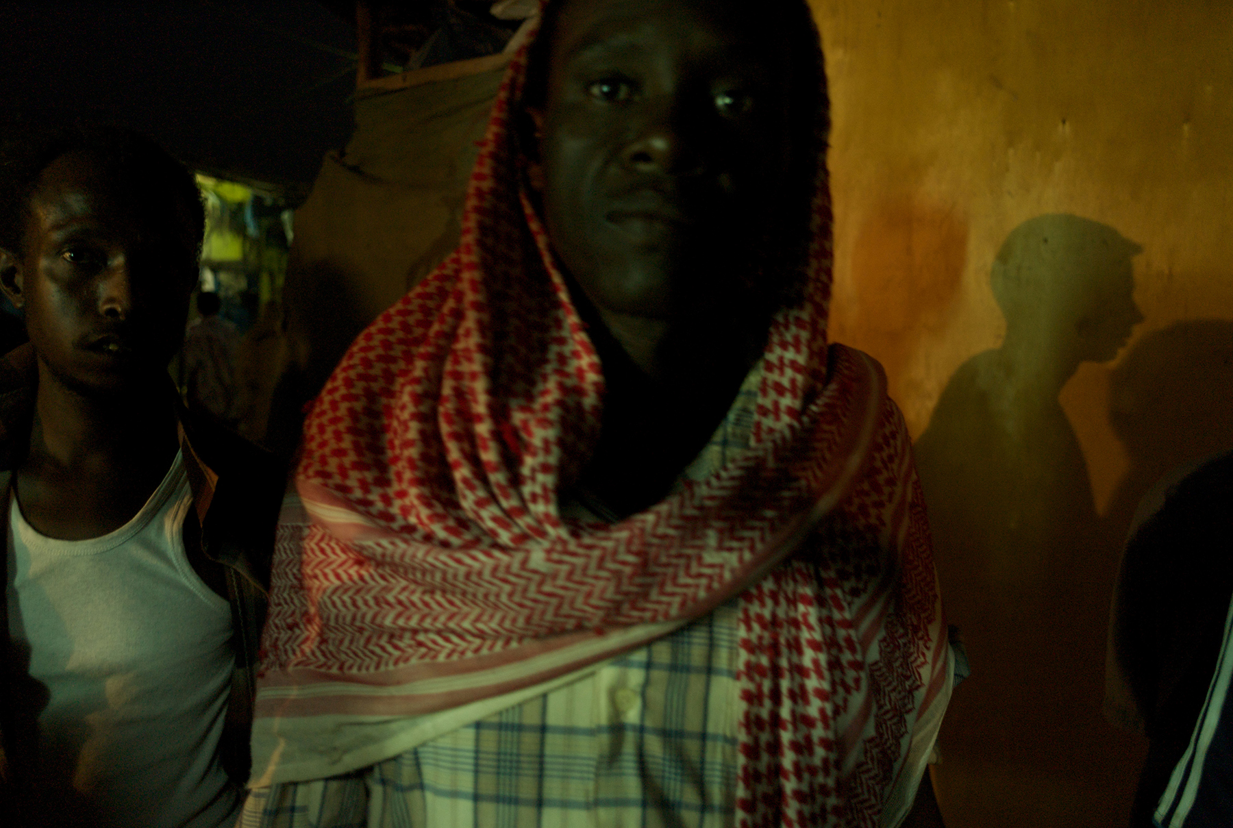 Basatine, Yemen, March, 2008. Back in the slums of Basatine, Mohamed returns late in the evening after a fruitless day spent walking Aden's streets in search of work. Having arrived in Yemen from Bossaso two months ago, Mohamed is just one of just eleven men to have survived a perilous journey across the Gulf of Aden. He is still traumatized, having witnessed one hundred of the other passengers on board the tiny boat drown as they capsized at sea.