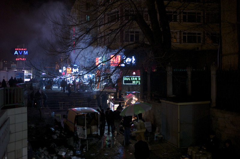 Turkey, Istanbul, January 2012, Moneychangers and second hand mobile phones sellers ply their trade around a busy, neon-lit junction in Istanbul's downtown Aksaray district.