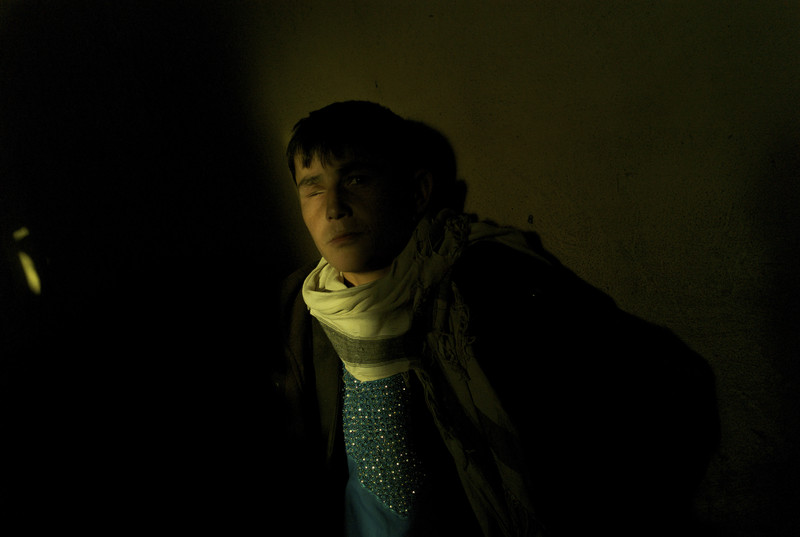 Afghanistan, Kabul, March 2012, Travelling as part of a group of six young men, sixteen year old Abdul Wased rests up against the wall in a mud built back room of a mosafer khana at the Company area bus station west of Kabul.