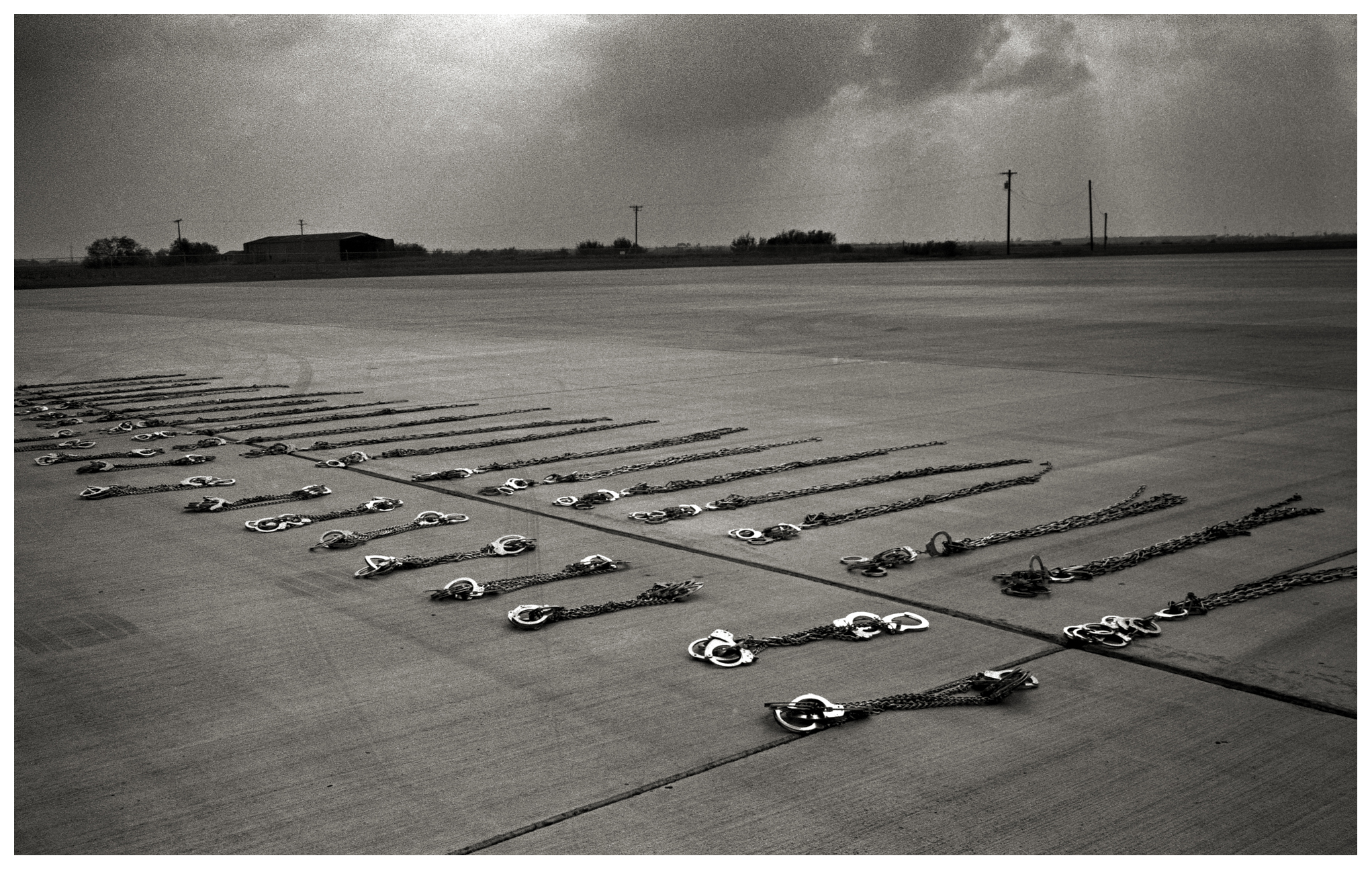 Handcuffs lie on the ground before being put away after shackling a group of undocumented immigrants who were being transported from Pennsylvania to the border crossing at Hidalgo. All the men had spent time in county jail in Pennsylvania and were sent back acrosss the border to Reynosa, Tamaulipas, Mexico.Thousands of Mexican and Central American migrants are returned to their home countries each year by the United States Immigration and Customs Enforcement or ICE. The agency operates about 48 flights each week to deport people from the United States back to their country of origin. Depending on the crime the migrants commit will determine whether or not they will be shackled throughout the flight. The flights originate from various parts of the United States. Approximately 400,000 people were deported this past year.