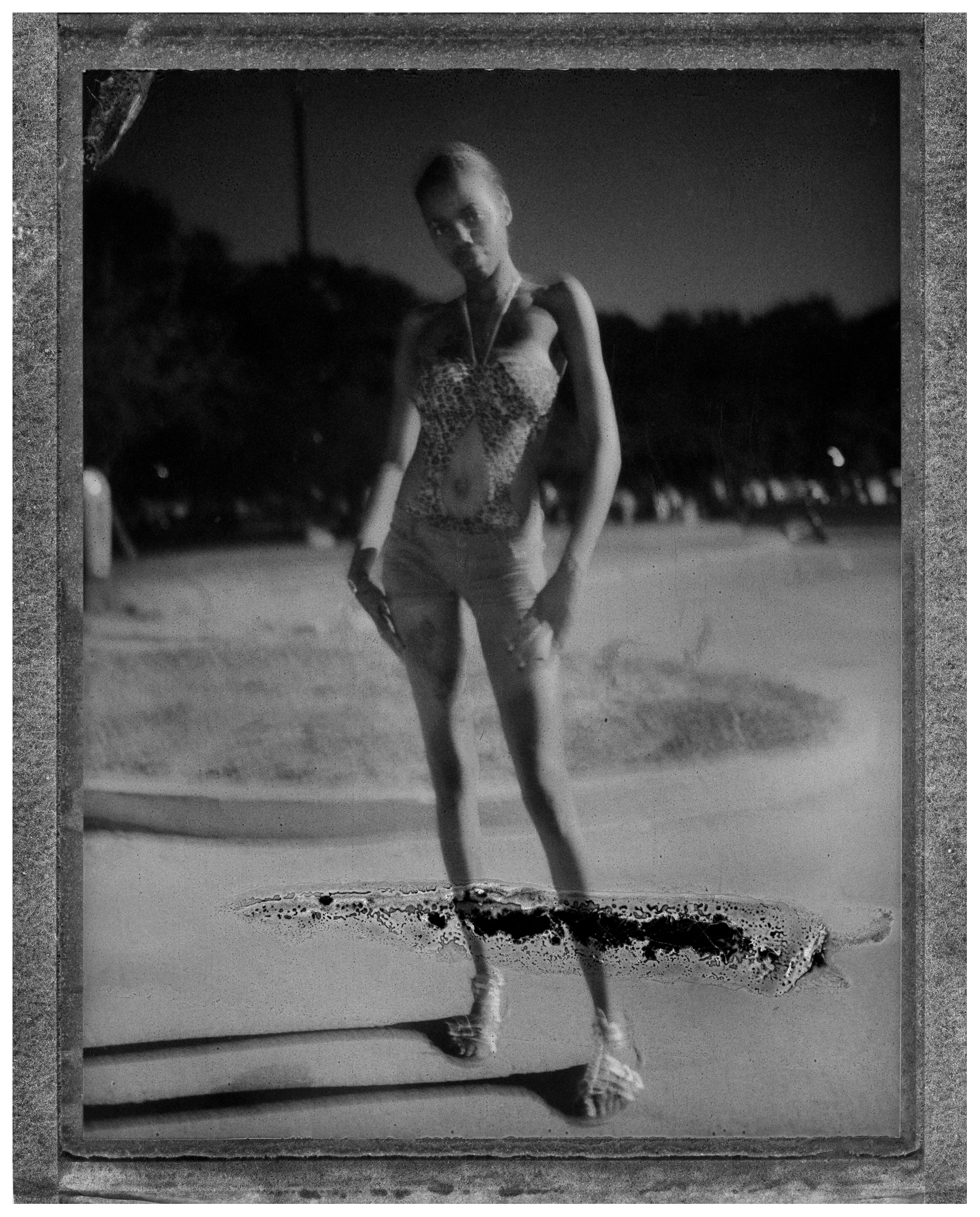A young woman poses for her picture at Rainbow Beach shortly after the fireworks ended on July 4th. Chicago's South Side