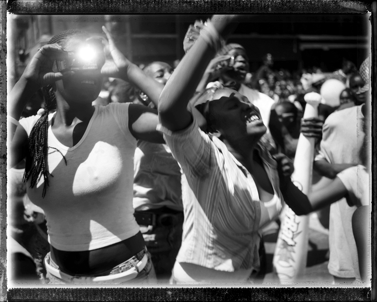 USA, Chicago, May 2005, Fans of Yung Jock scream and tossle for attention for the well known rapper as he rode by on the WGCI Radio Station's float in the annual Bud Billiken Parade in 2006.