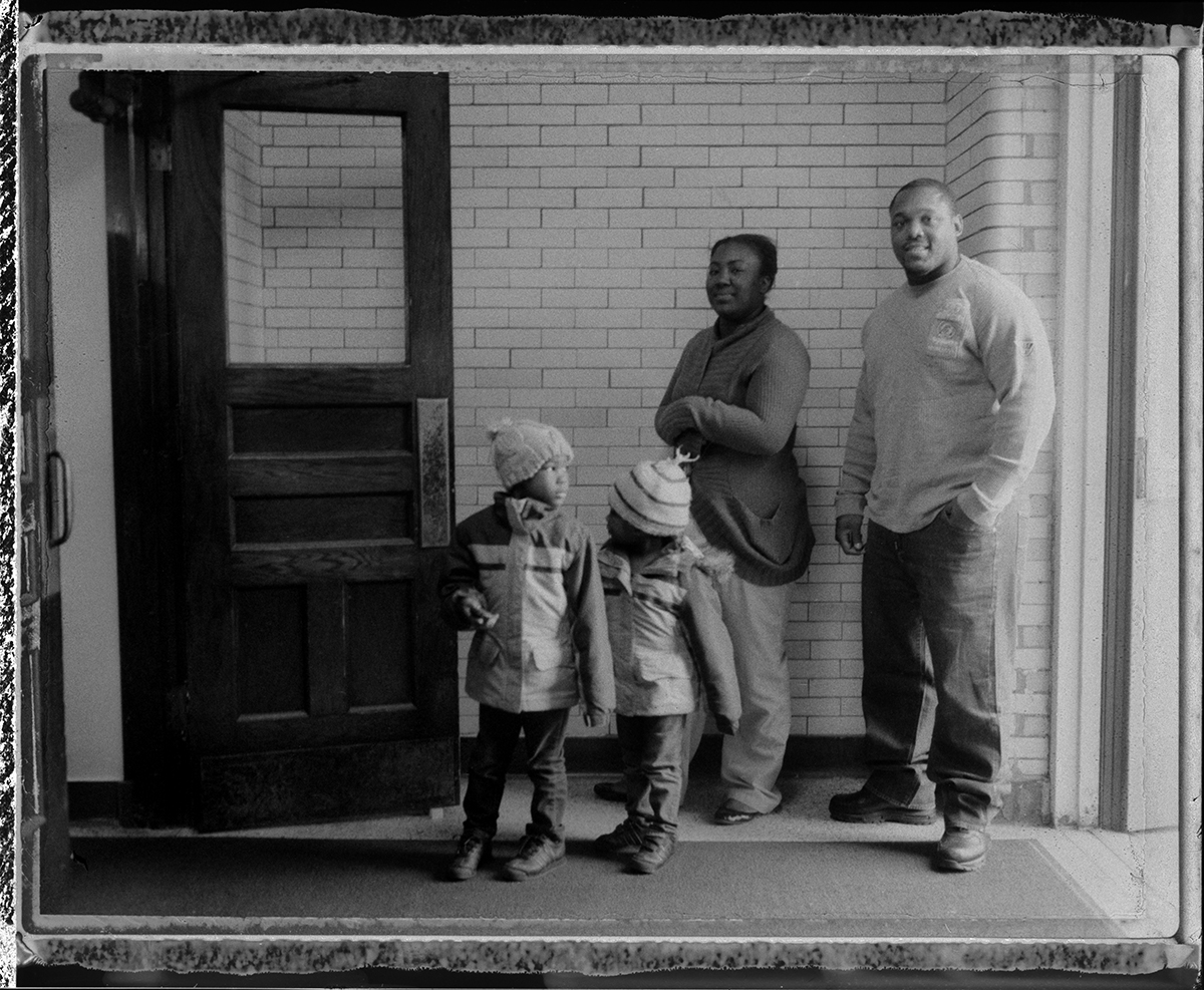 """USA, Chicago, November 2012, Keith Green and Lydia Ross wait to vote with their children Keyana and Lydia. Keith, who spoke for the family, said that voting today was """"Just as meaningful this time, if not even more.... We're moving forward. There's no reason to change now. Give him four more years."""""""