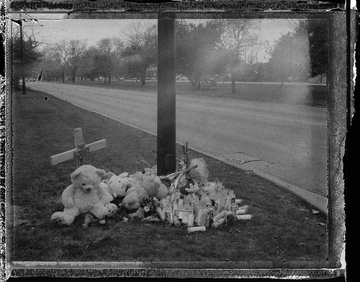 USA, Chicago, April 2012, Shrines and informal memorials pop-up throughout the South Side for people who die unexpected and violent deaths. Two young people were killed when a hit and run driver plowed into the Ochoa's family car.