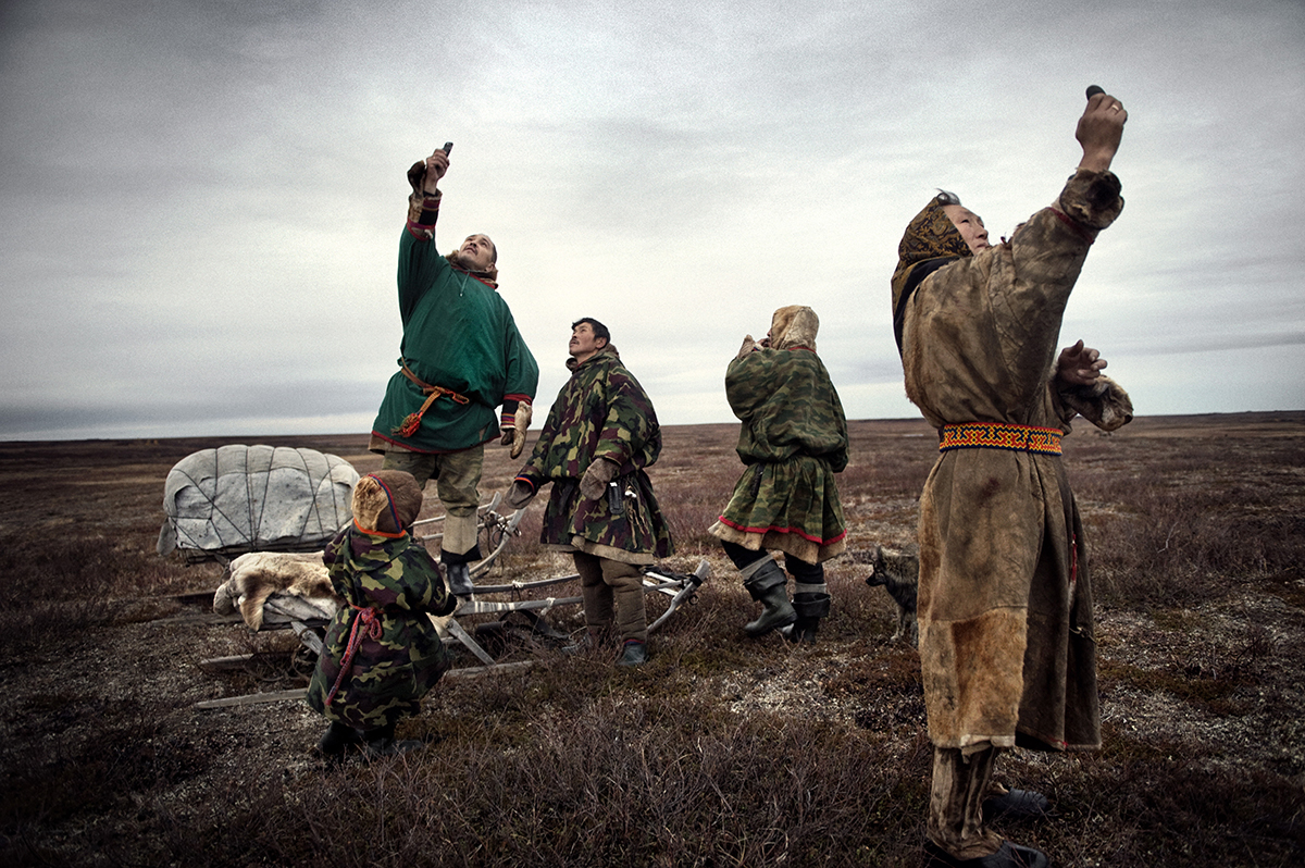 Russia, Yamal, October 2009,The Nenets family tries to find connection for their mobile phones.