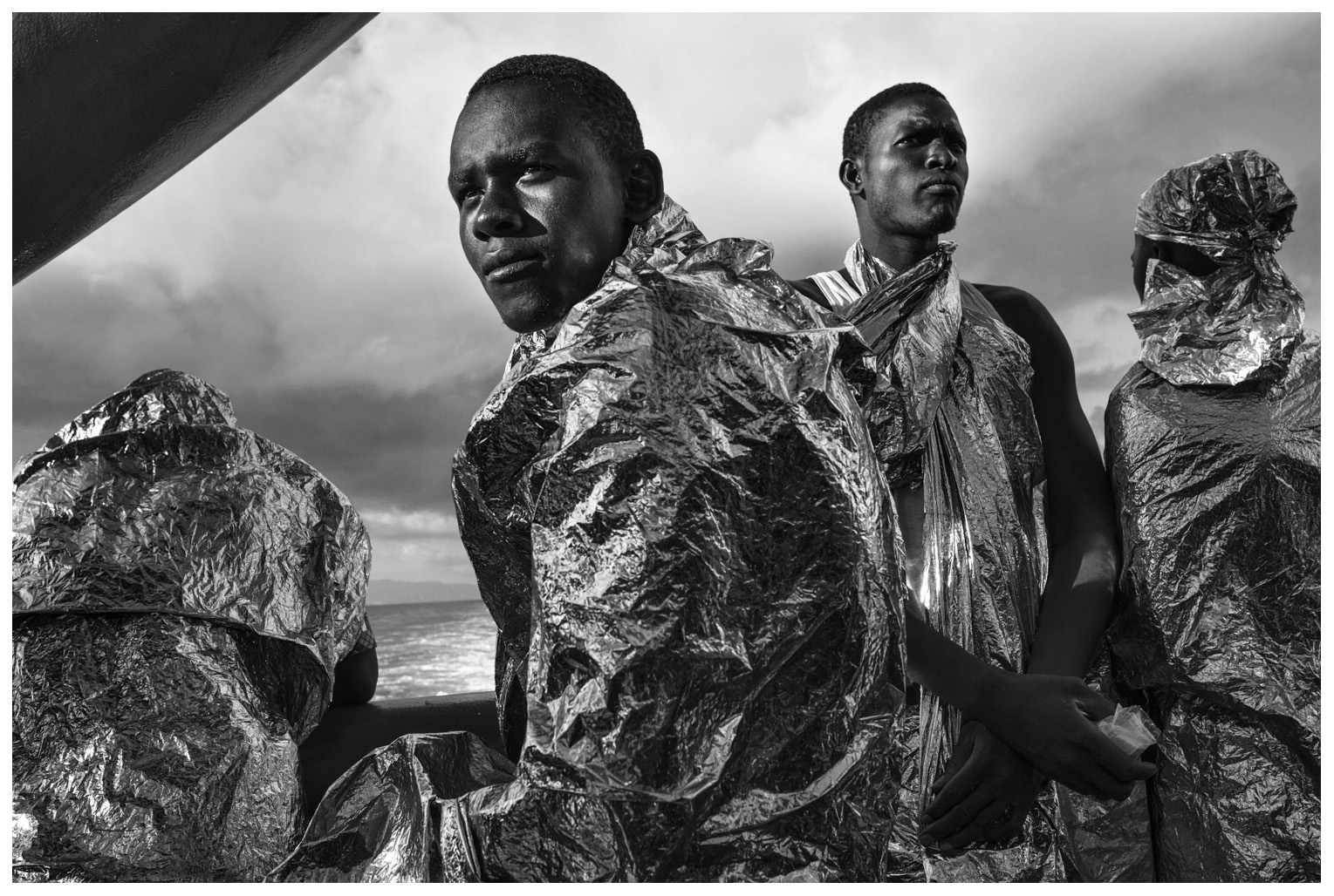 After spending two days and two nights on the MSF Bourbon Argos, rescued migrants catch sight of the Italian coast for the first time. 23 August 2015