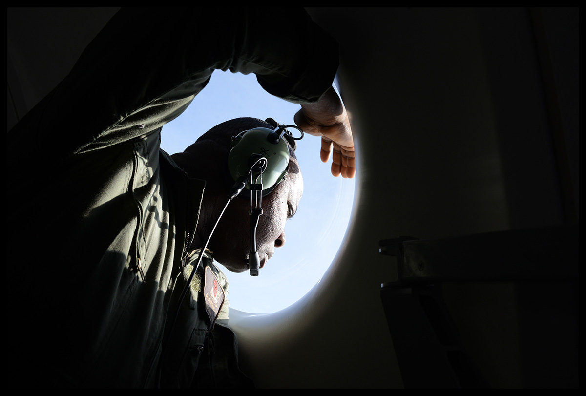 Nigeria, Madagali, March 2015, An Air Force officer observes the ground. The Nigerian Armed Forces are using ATR 42, for air surveillance and collect intelligence on the ground.