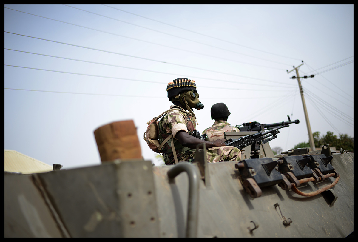 Nigeria, Mubi, March 2015, Nigerian troops patrol the streets of the recently recaptured city of Mubi in a stabilisation phase of the operation Zaman Lafiya.