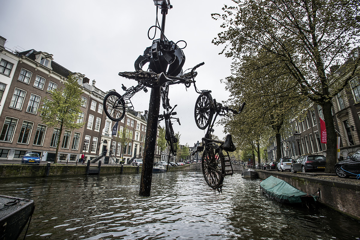 Netherlands, Amsterdam,May 2017, A special boat cleans the canals of bicycles, on average 20,000 are fished out of the canal every year. Often safes are found as well, emptied after being stolen and thrown into the canal.