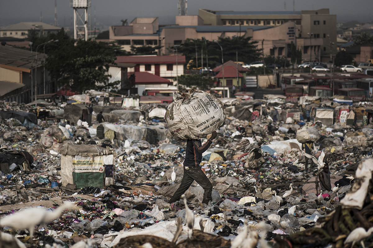 Nigeria, Lagos, 27 January 2017The Olusosun landfill in Lagos receives between 3-5000 tons per day and is about 45 ha in size. About 5000 scavengers work here and often also live. They collect anything that is recyable like plastics, textiles, electronics, paper etc. The problem is that the landfill is full and the city wants to close it down. The question is where it will go, there are no incinerators and the infrastructure to formally recycle is lacking. There is one other landfill, but it needs to close as well.Remarkable is that the landfills in Lagos smell less compared to other landfills in the world: Nigerians throw away less food, because they either finish their plate or feed it to the animals.Kadir van Lohuizen / NOOR