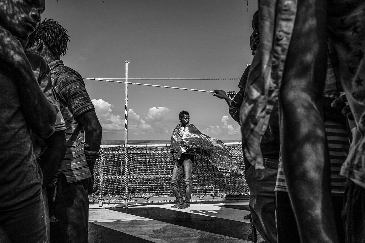 Mediterranean Sea, 23 August 2015, After spending two days and two nights on the MSF Bourbon Argos, rescued migrants catch sight of the Italian coast for the first time.