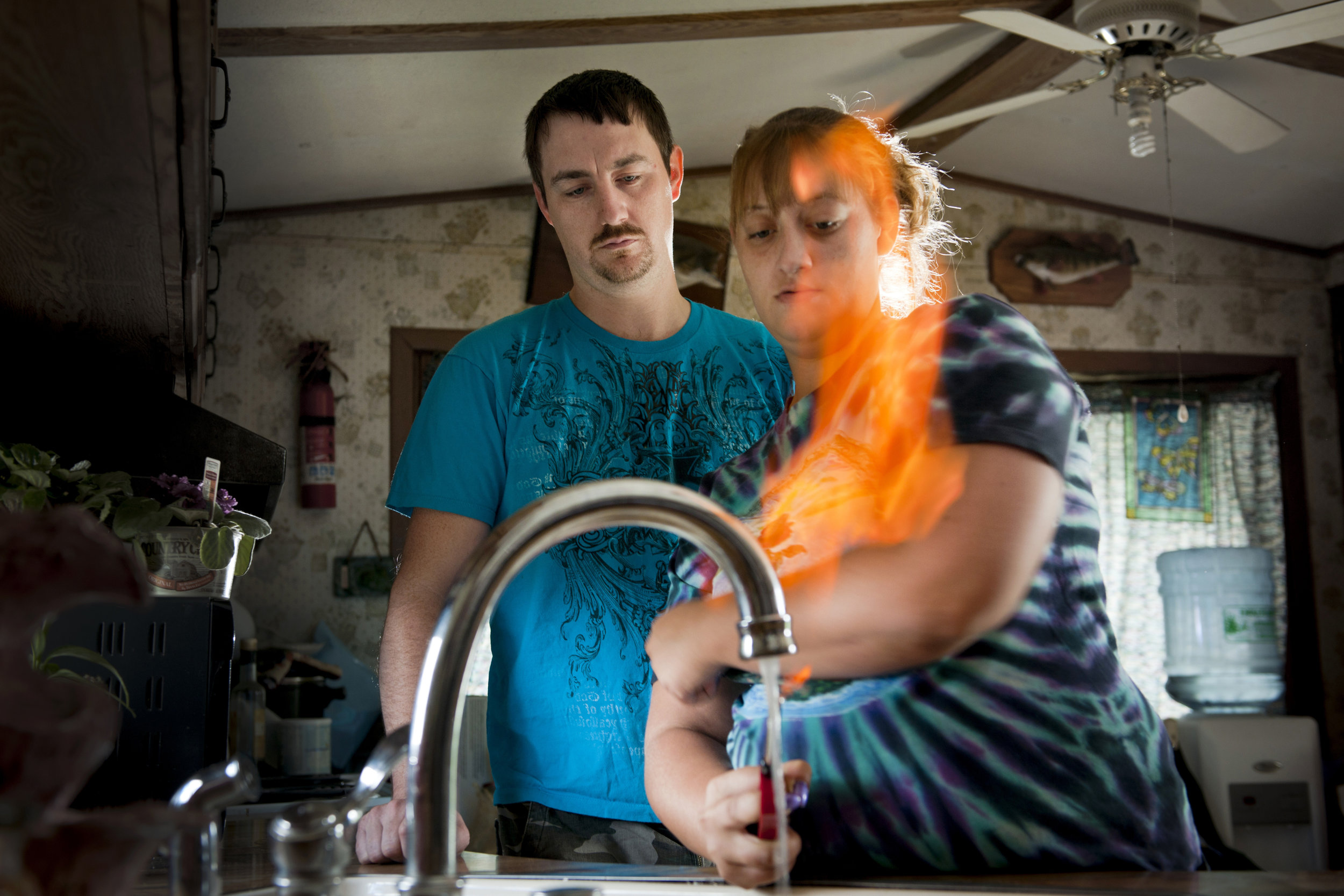 Earth Air Fire Water - Gas Shale Exploration  Jodie Simons and Jason Lamphere demonstrate how their sink water lights on fire. It is full of methane. Their water was pristine before gas drilling started. Their neighbors water is also contaminated by the state Department of Environmental protection has not determined the source of the problem. They have been without clean drinking or bathing water for months. Their animals also became sick and they now give bottled water to their horses. A methane vent rises from their property.