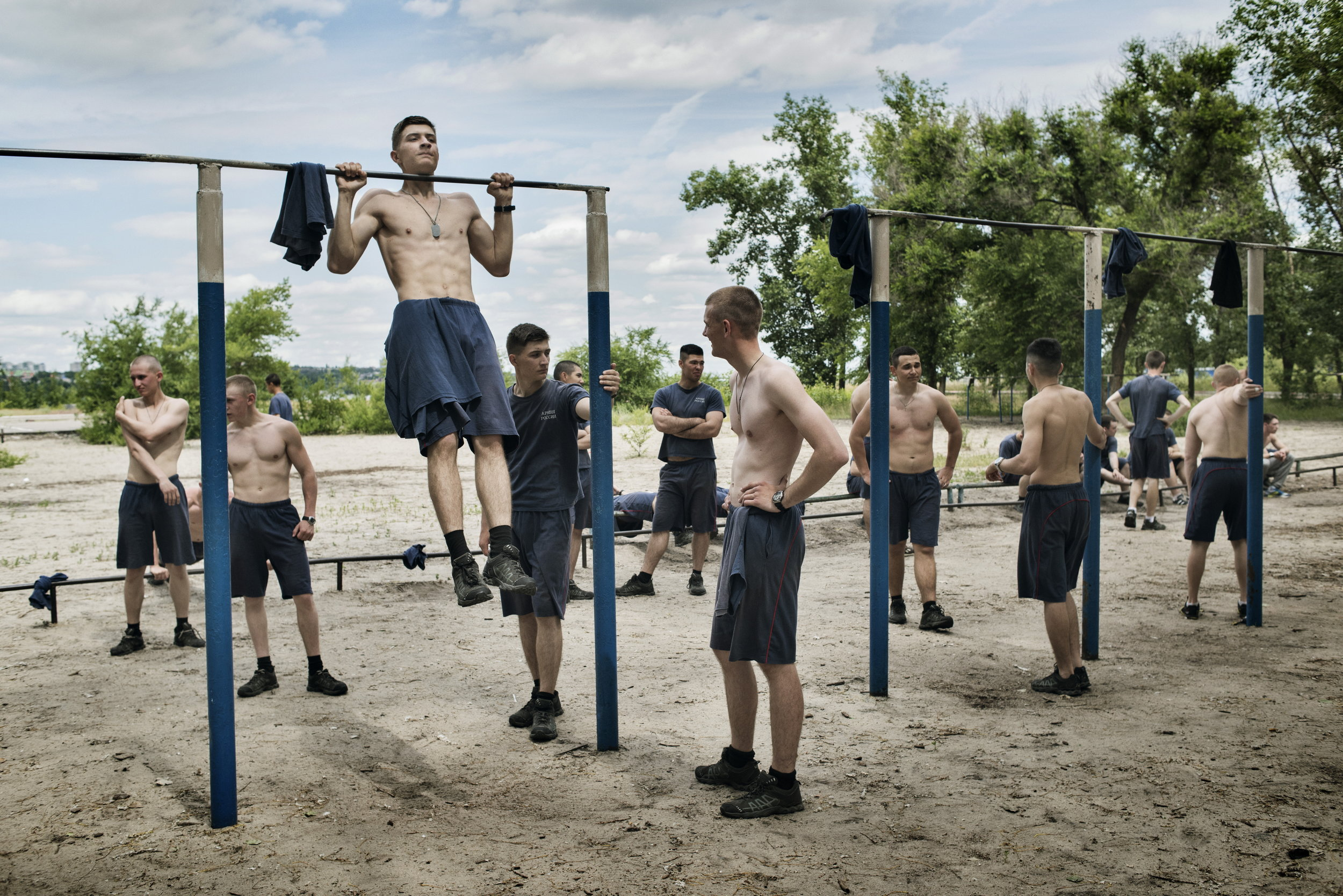 Russia, Voronezh, June 2016, Young men do morning exercises.
