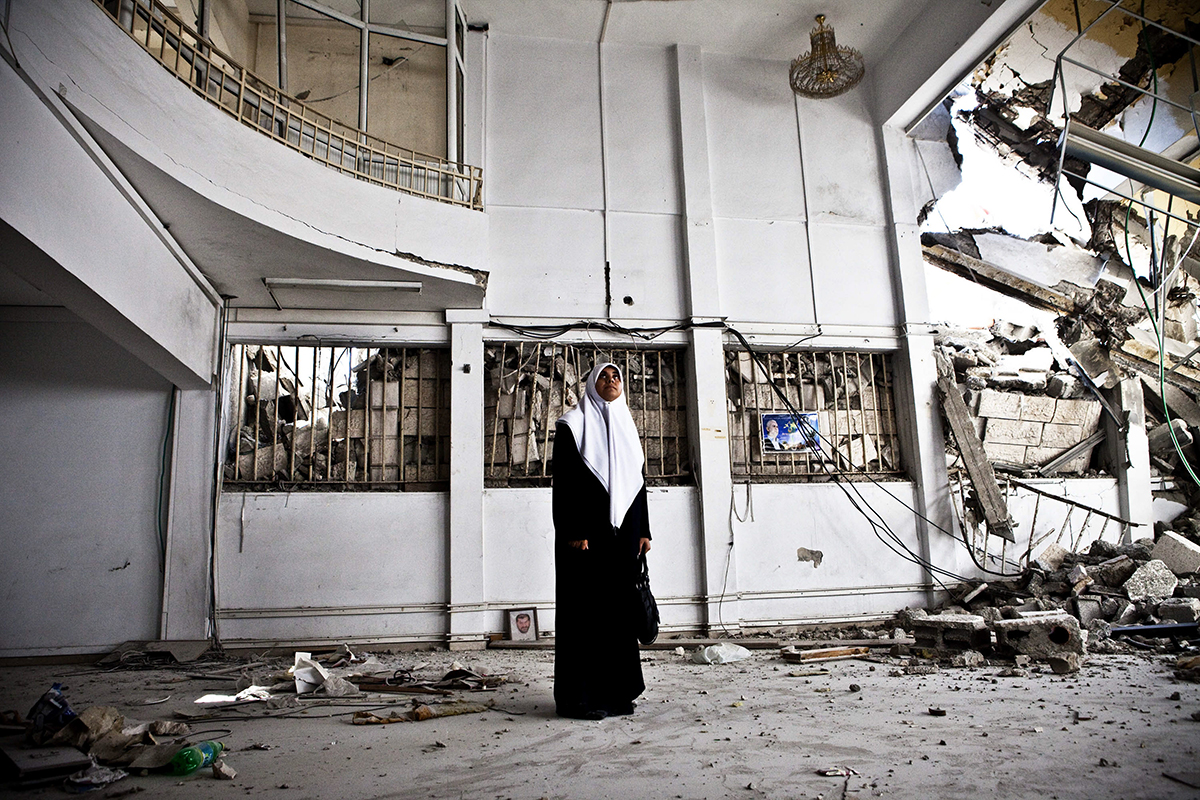 Occupied Palestinian Territories, Gaza City, October 2009, Huda Naim (a member of the Palestinian Legislative Council and Secretary of the Hamas Bloc) examines the damage to a government building after 2008-09 Israeli Cast Lead assault.