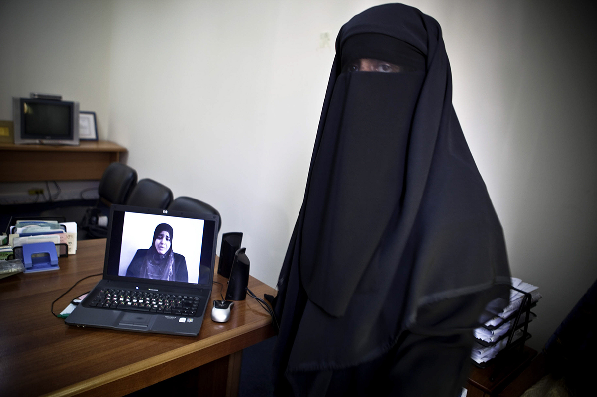 Occupied Palestinian Territories, Gaza City, October 2009, Deema Aydieh, a journalist, prepares to leave her office for a video shoot.