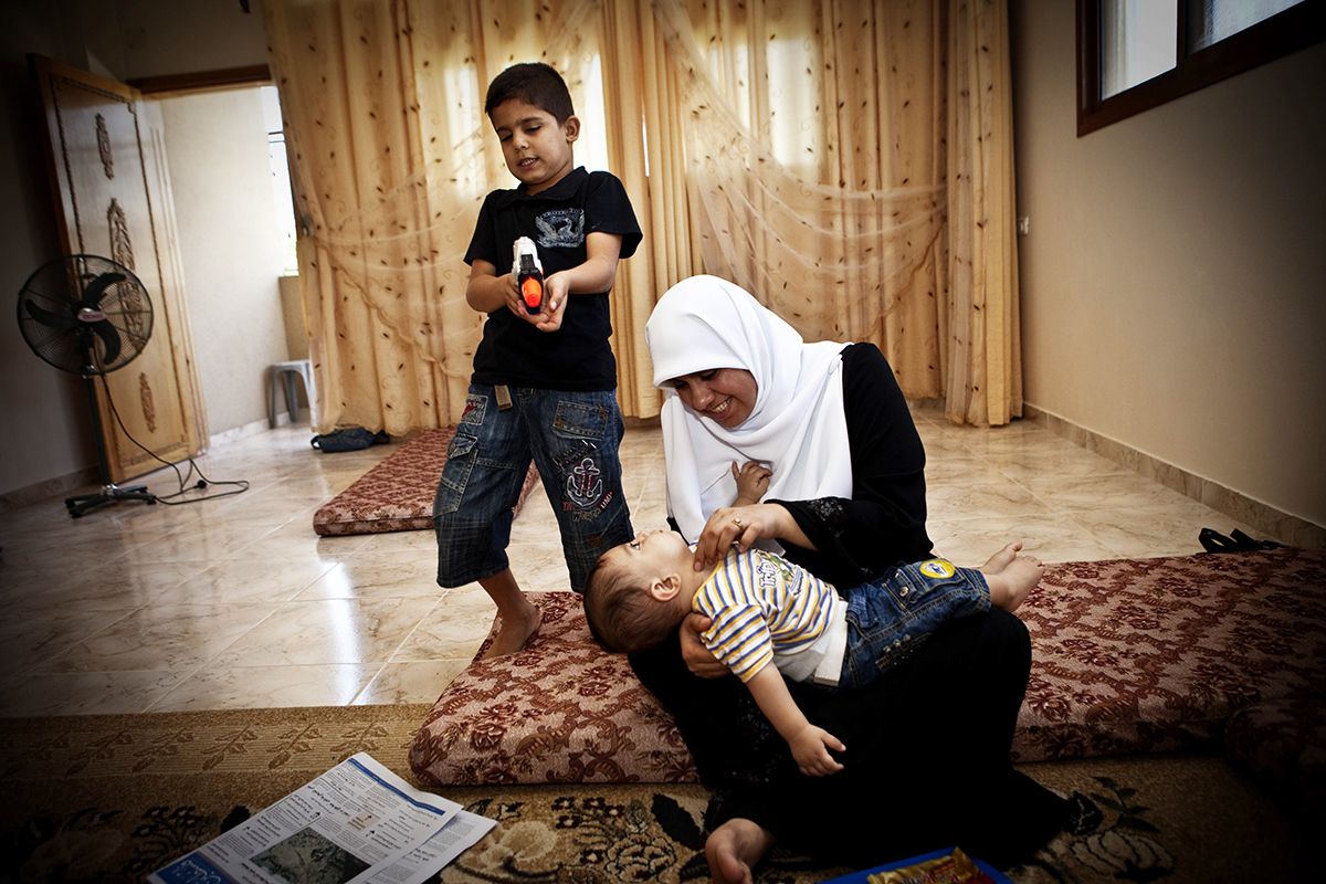 Occupied Palestinian Territories, Gaza City, October 2009, Huda Nae'm, a Hamas lawmaker in Gaza, plays at home with her children.