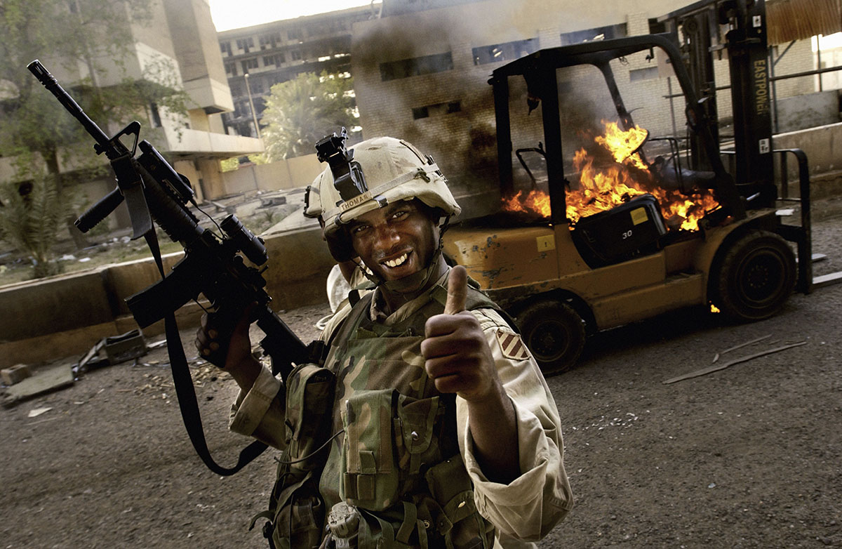 Iraq, Baghdad, May 2003, A US soldier gives the thumbs up after the capture of numerous looters.