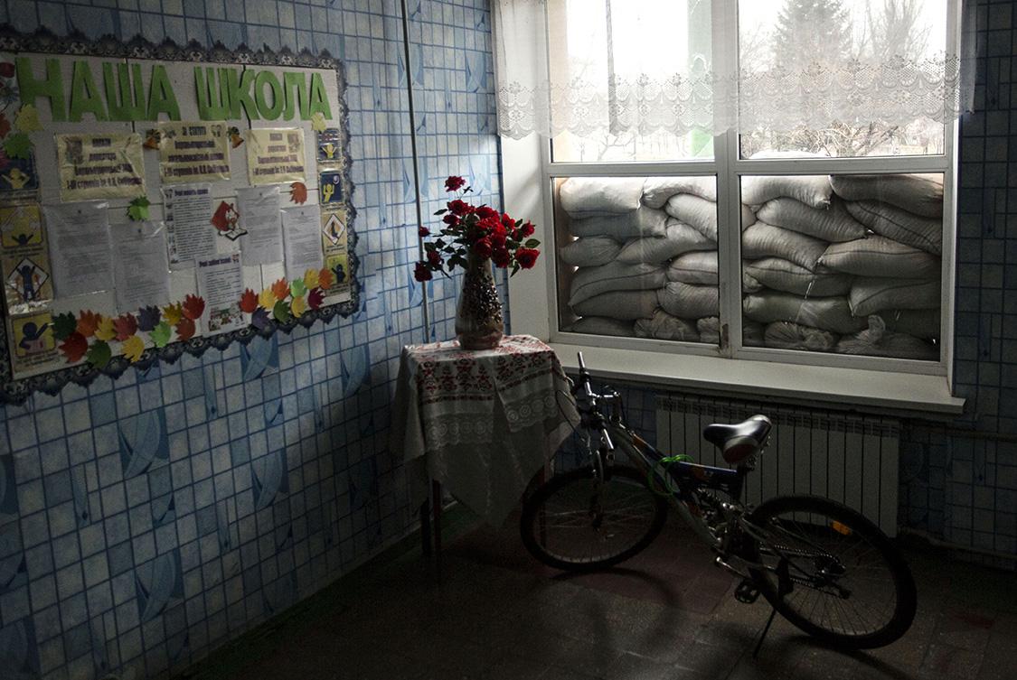 A view of a school window blocked with sandbags in case of shelling in Verkhnyotoretske, Donetsk area, Ukraine.