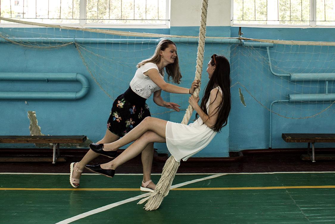 Tatiana Kolesnikova and Oleksandra Kovalyova play on a rope in a school gym in Shchastya, Luhansk area, Ukraine. The name of the town Shchastya translates to �happiness,� from both Ukrainian and Russian.