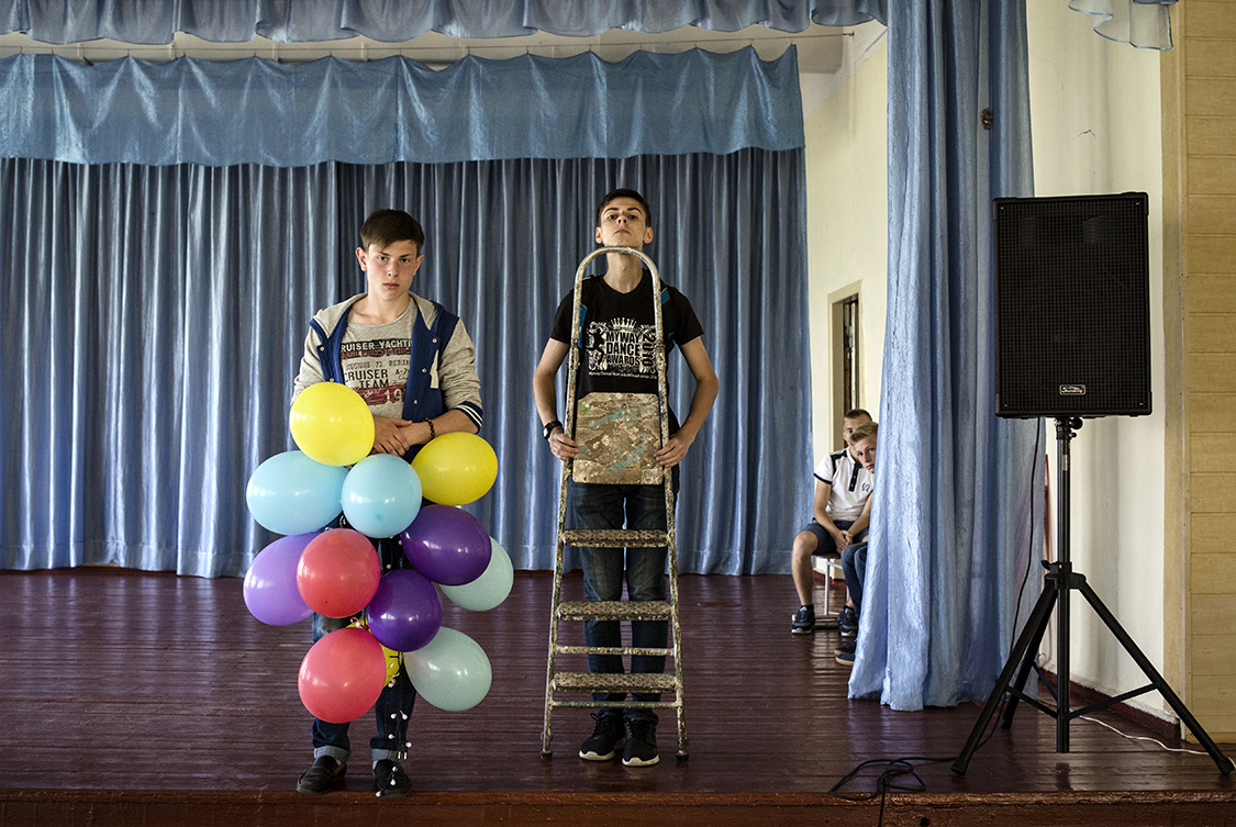 Classmates, Ilya Gudzovatiy and Ilya Shlykov, decorate the school's assembly hall in Shchastya, Luhansk area, Ukraine. Shchastya is a small provincial town in some 10 km from the front line.