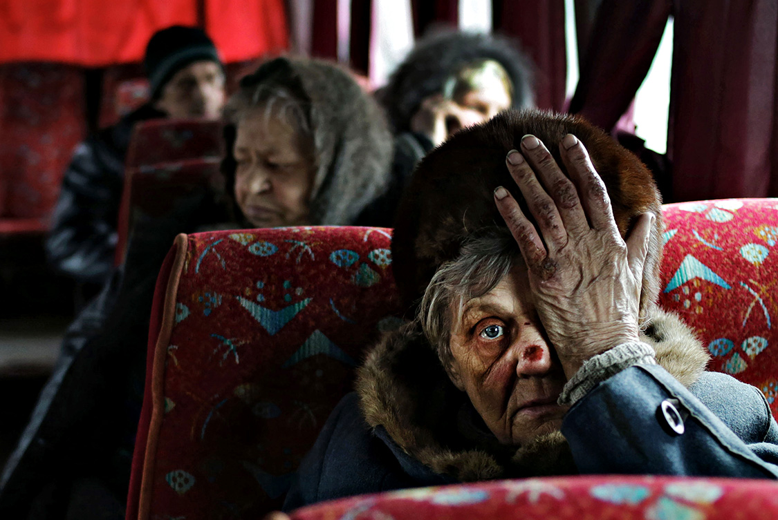 - Is there a blood in my face? A woman who was just evacuated from an embattled town of Debaltseve, sits in a bus.