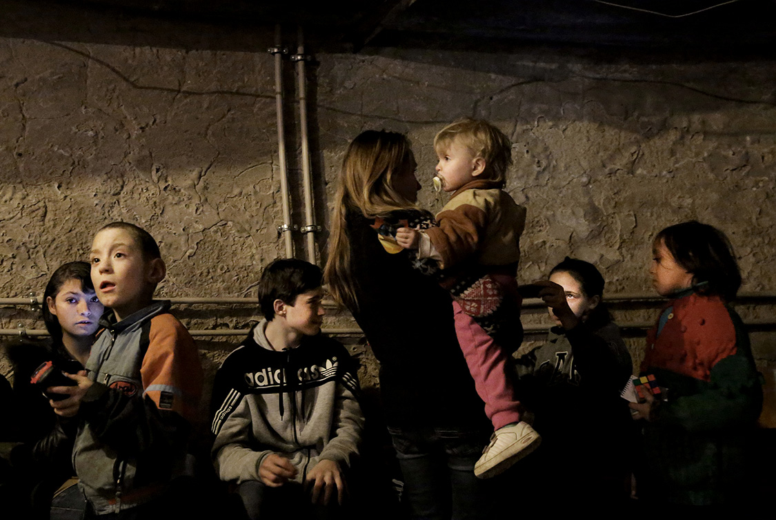 Children and their parents stay in a bomb shelter in the Palace of Culture of Petrovskiy district in Donetsk, Ukraine.