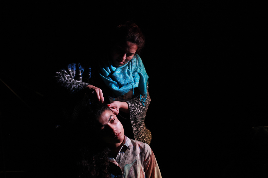 """Elena Duminica is braiding Mihaela Dragan's hair before a performance in Cluj-Napoca, Romania, on November 5th 2017. The play was part of their tour """"Roma Theater is not Nomadic"""", that tried to lobby for the creation of a Roma state funded theater."""