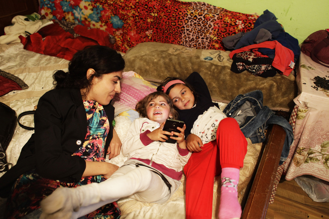 Mihaela Drăgan is talking to Roma girls in the house of a woman, after a theater performance, in a poor community in Valea Seaca, in the East of Romania, on April 16th 2016.