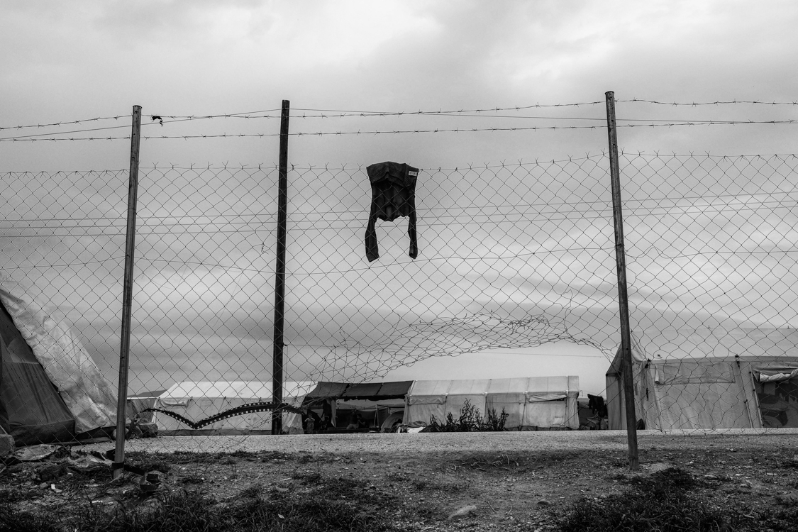 Children's clothes hang from a fence outside Idomeni train station, where thousands of migrants and refugees are stuck at a makeshift refugee camp following the closing of the Macedonian border.