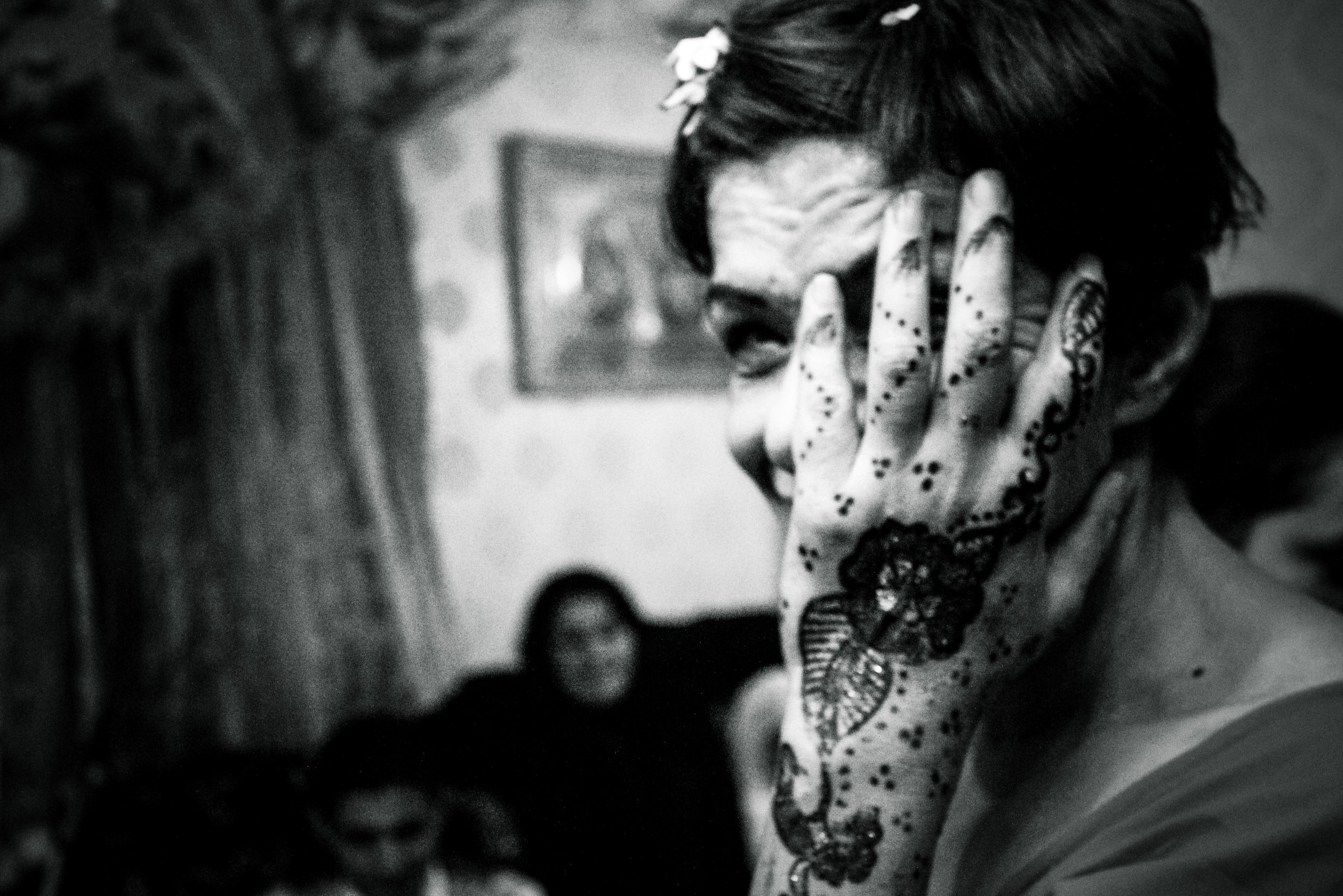 """France, Marseille, 08 December 2012Nadege, aunt of the future groom, showing her Henna. Henna ceremony is a symbolic ritual where the young woman begins a new stage of her adult life as a wife. The oldest woman of the family has to apply henna on bride's hands, but unmarried girls are also decorated, so that """"God"""" would send them a husbandClaudia Cuomo / NOOR"""