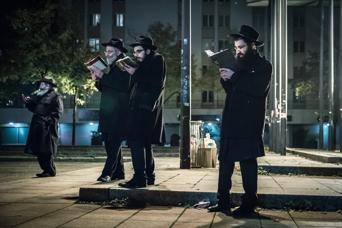 On the 6th night of the Sukkot celebration, men from the Loubavitch community, a branch of Hasidism, isolate themselves to study  the Deuteronomy book. They will be spending the entire night reading it, before going to the synagog early in the morning.