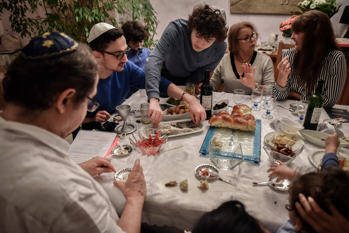 A family holds the Roch Hachana diner, the Jewish New Year celebrated in September. This celebration is particularely observed by Jewish communities, no matter how practising they are.