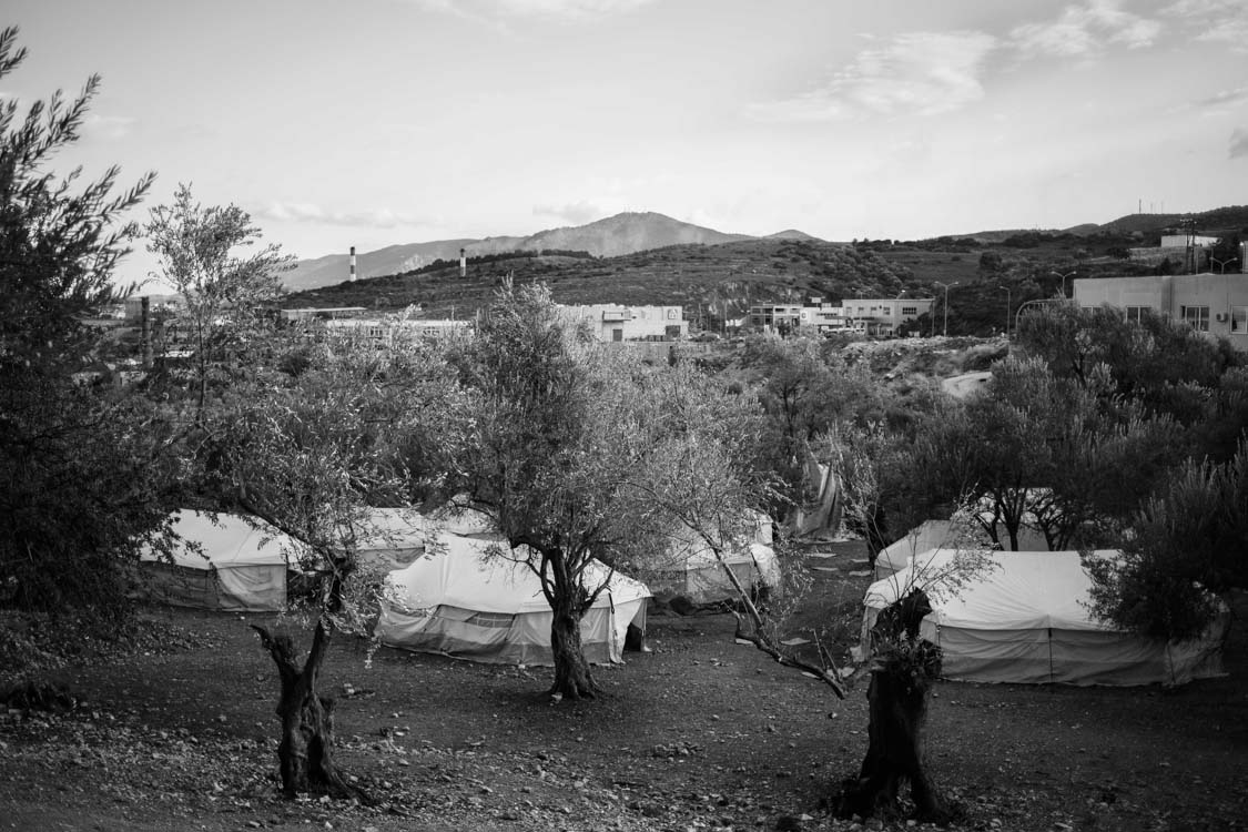 A view of the tents overlooking the lush hills and amidst the ancient olive trees of Lesbos island, Greece.