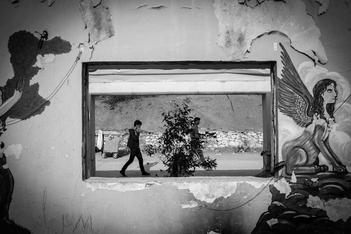 An everyday scene in Moria refugee camp for non-Syrian refugees. Taken in a decaying old building in the camp.