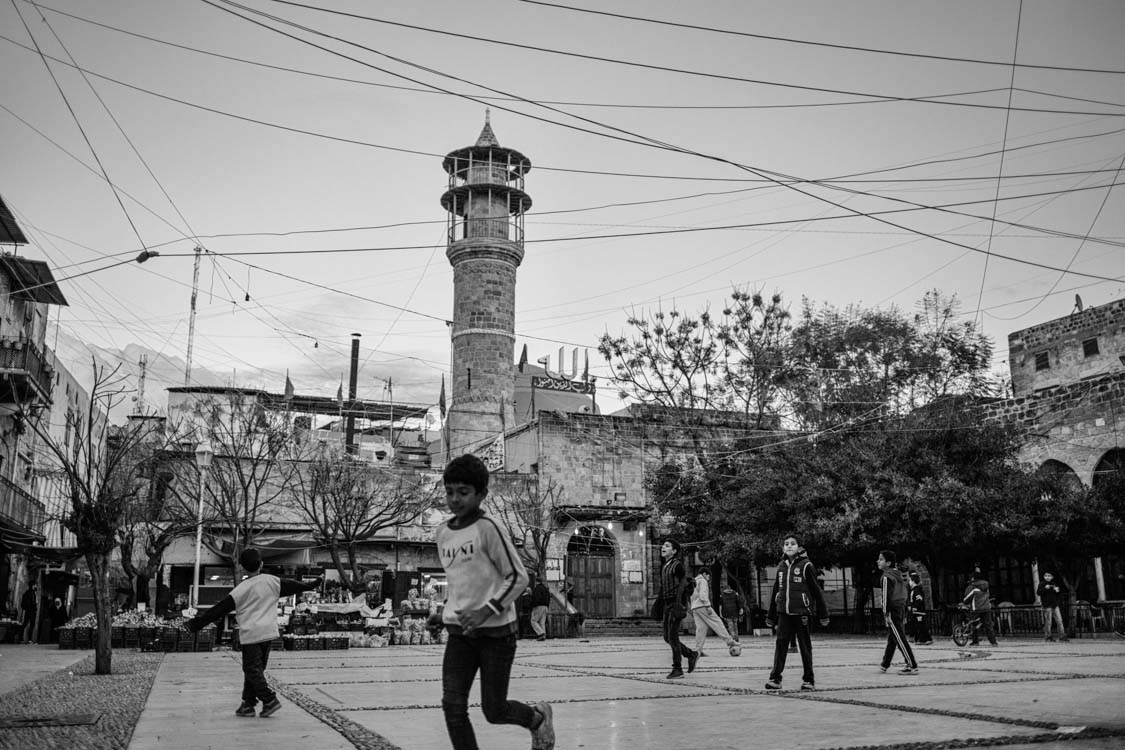 Children play outside in a souk square in the centre of Saida just outside the refugee camp of Ain el Hilweh. Lebanon.