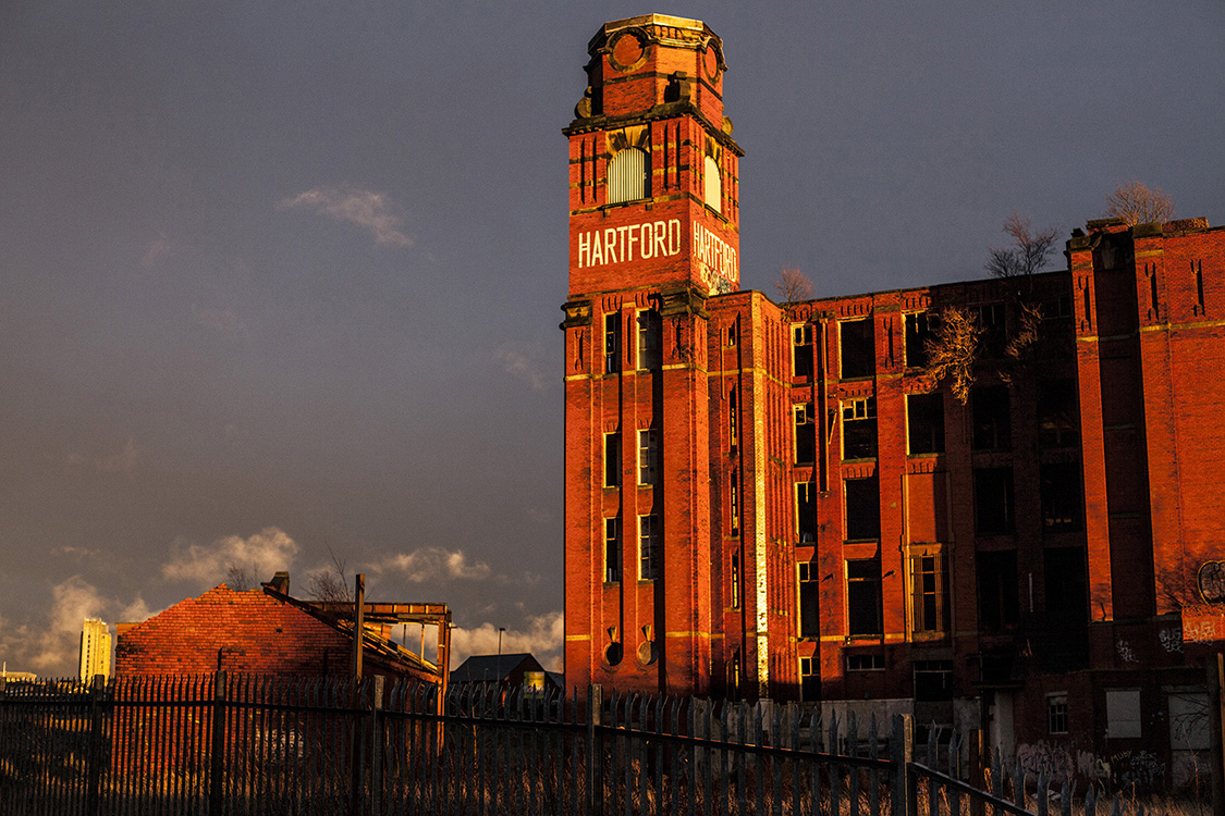 Oldham was once the cotton capital of the world and had a strong economy. Now however, the mills are all shut down leaving the town with few jobs but a large and divided population. They sitas a reminder of Oldham's more prosperous time.