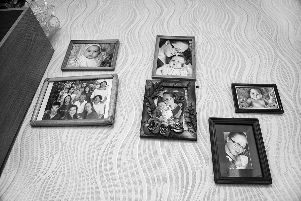 """photo from the project """"Lullabies for Alyona"""" Karaganda 2017in the house, wall with family photos"""
