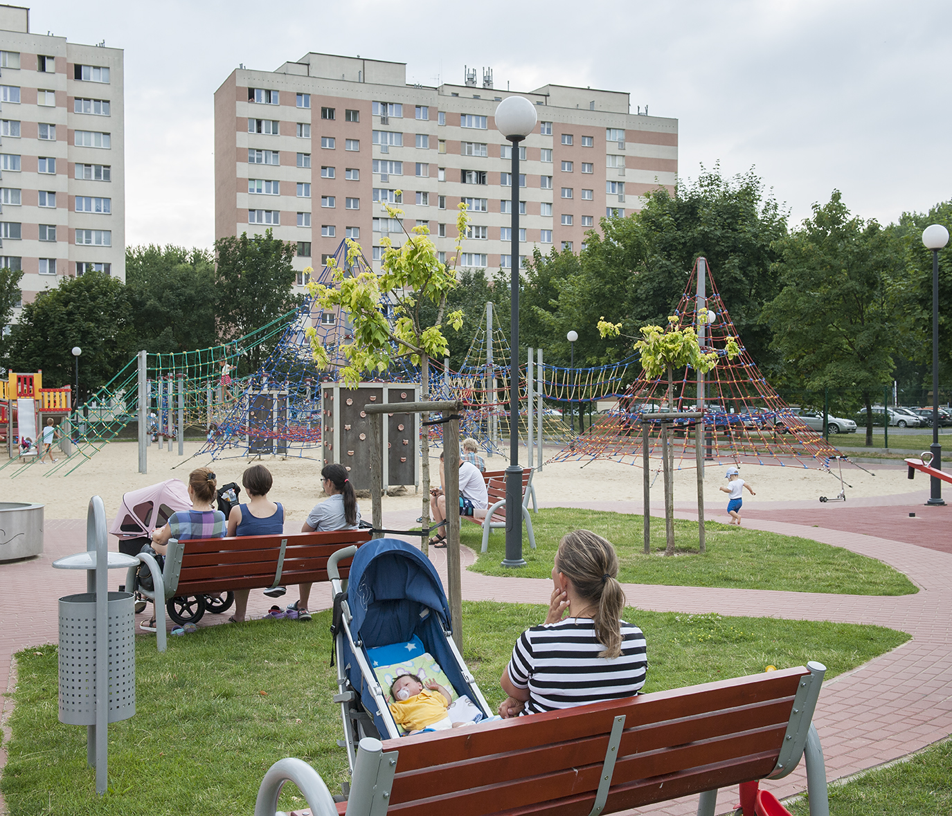 Katarzyna with her doll and children in the play park. Most of the time when Katarzyna takes her kids out the doll comes too. People approach her to admire the newborn baby. Not being able to tell the difference once told their reactions vary – from excitement to shock.
