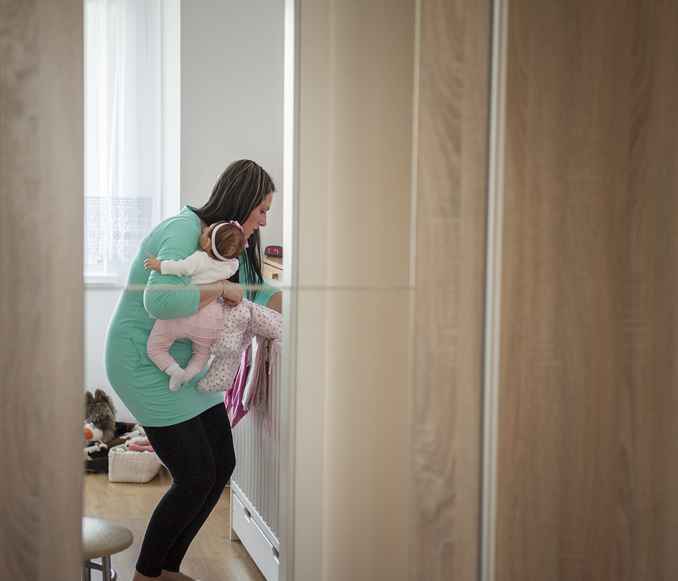 Magdalena is putting her doll to the crib. Lorcia was part of the family for seven years because Magdalena could not conceive. A year ago she gave birth to a baby boy. The doll now safely stored in a cupboard is no longer needed - yet fulfilled her therapeutic purpose